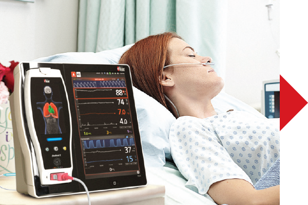 Masimo - Configure alarm thresholds - woman laying hospital bed with device