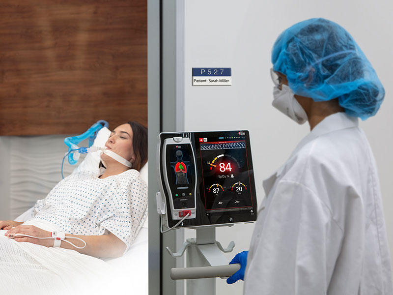 Masimo - Doctor outside of patient room monitoring via Root device